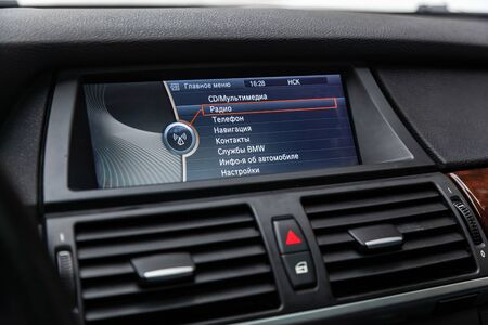 Novosibirsk, Russia - February 16, 2019:  BMW X5,close-up of the dashboard, monitor with navigator,radio, phone, player and other multimedia. Photography of a modern car on a parking in Novosibirsk Standard-Bild - 133071864