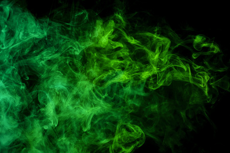 Fog colored with bright green gel on dark background