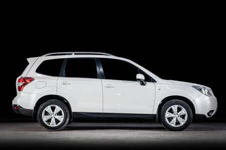 Novosibirsk, Russia - February 19, 2019:  Subaru Forester, side view. Photography of a modern car  on a parking in Novosibirsk against a black wall Standard-Bild - 133071883