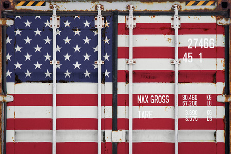 Close-up of the container with the national flag of USA.  The concept of USA  export-import and national delivery of goods.