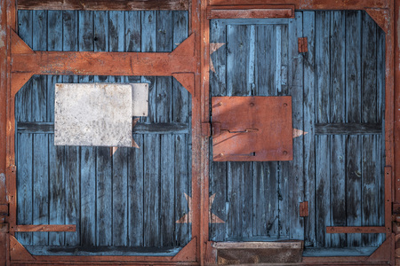 Closeup of an old warehouse gate with a national flag of the Federated States of Micronesia. The concept of export-import Federal states of Micronesia, storage of goods and national delivery of goods. Flag in grunge style