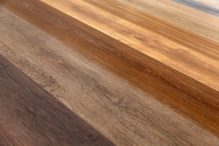Different soft wood surface as background, wood texture. Wood wall. Close-up of a wide range of laminate in different colors.