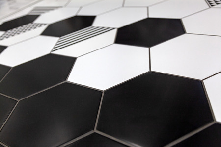 Black and white colored mosaic background tiles. Close up cleaning black and white mosaic tiles shower wall texture background