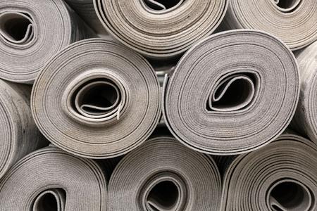 Close up roll of car insulation polyester fiber or felt background. Polyethylene Insulation isolation foam with aluminum foil in rolls Reklamní fotografie