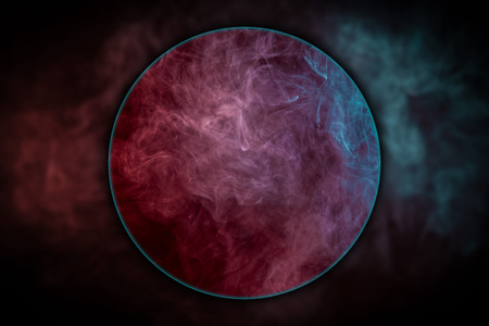 Close-up  blue and red bomb smoke  blown under a magnifying glass on black isolated  background 写真素材