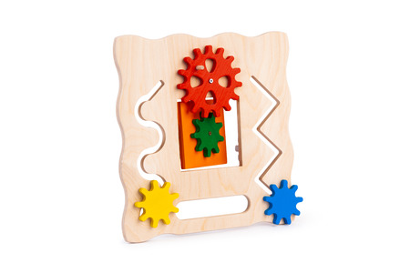 Wooden eco-friendly busy board - educational toy for children, babies on a white isolated background, consisting of multi-colored wooden puzzle pieces, maze, gear, sorter