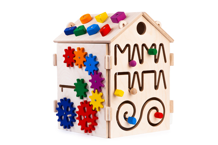 Wooden eco-friendly busy board house - educational toy for children, babies on a white isolated background, consisting of multi-colored wooden puzzle pieces, maze, gear, sorter