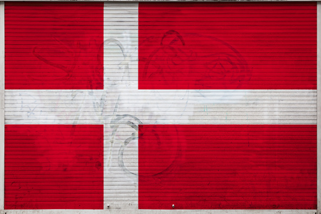 Close-up of old metal wall with national flag of Denmark. Concept of Denmark export-import, storage of goods and national delivery of goods. Flag in grunge style