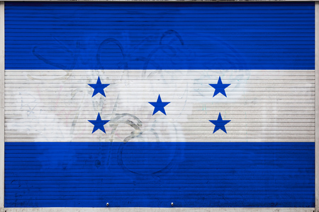 Close-up of old metal wall with national flag of Honduras. Concept of Honduras export-import, storage of goods and national delivery of goods. Flag in grunge style Archivio Fotografico