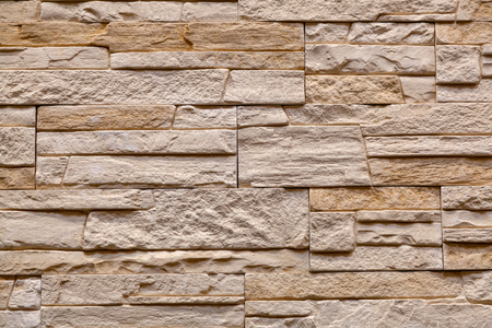 Background of brown stone wall made with blocks . Pattern of slate wall texture and background