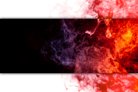 Abstract art colored  blue and red smoke on black isolated background. Stop the movement of multicolored smoke on black and white background Reklamní fotografie