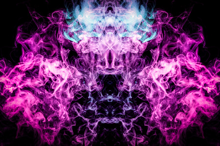 Thick colorful smoke of blue, pink and purple  in the form of a skull, monster, dragon on a black isolated background. Background from the smoke of vape. Mocap for cool t-shirts Banco de Imagens