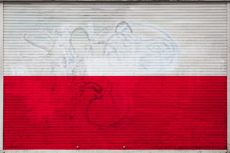 Close-up of old metal wall with national flag of Poland. Concept of Poland export-import, storage of goods and national delivery of goods. Flag in grunge style