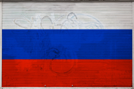 Close-up of old metal wall with national flag of Russia. Concept of Russia export-import, storage of goods and national delivery of goods. Flag in grunge style