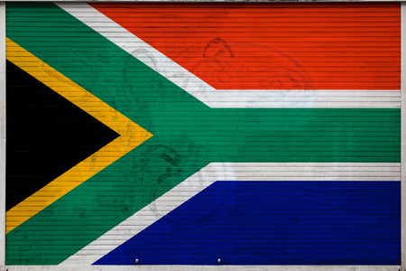 Close-up of old metal wall with national flag of South Africa. Concept of South Africa export-import, storage of goods and national delivery of goods. Flag in grunge style