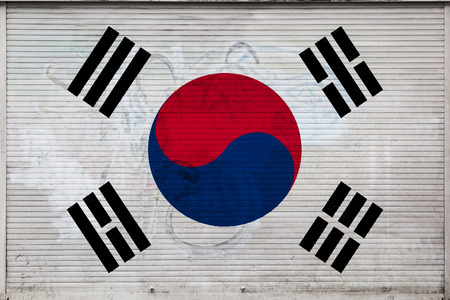 Close-up of old metal wall with national flag of South Korea. Concept of South Korea export-import, storage of goods and national delivery of goods. Flag in grunge style Imagens - 122125561