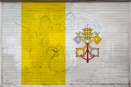 Close-up of old metal wall with national flag of Vatican. Concept of Vatican export-import, storage of goods and national delivery of goods. Flag in grunge style