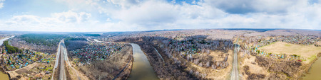 Aerial view, panorama: landscape of river, beach and forest, village with small houses and road.  top view of beautiful nature texture from drone Фото со стока