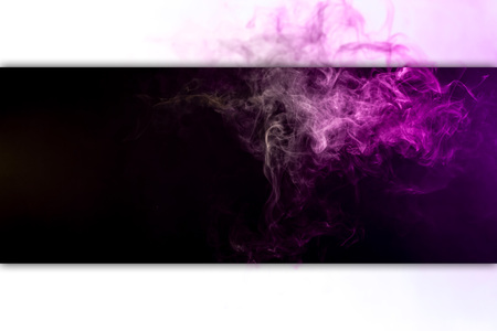 Frozen abstract movement of  explosion smoke multiple colors yellow and pink  on black and white  background. Background from the smoke of vape
