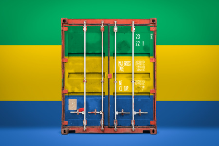 The concept of  Gabon export-import, container transporting and national delivery of goods. The transporting container with the national flag of Gabon, view front