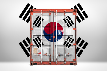 The concept of  South Korea export-import, container transporting and national delivery of goods. The transporting container with the national flag of South Korea, view front 免版税图像