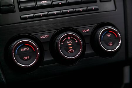 Ð¡lose-up of the car  black interior: adjustment of the blower, air conditioner and other buttons. Banco de Imagens