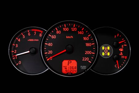 Car dashboard wuth red backlight: Odometer, speedometer, tachometer, fuel level, water temperature and more 版權商用圖片