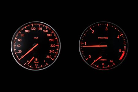 Car dashboard wuth red backlight: Odometer, speedometer, tachometer, fuel level, water temperature and more