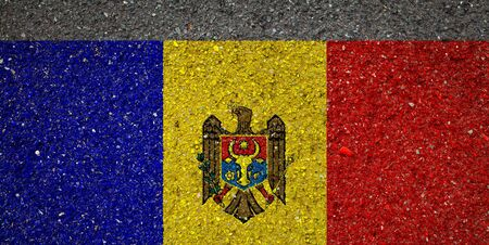 National flag of Moldavia on a stone background.The concept of national pride and symbol of the country.