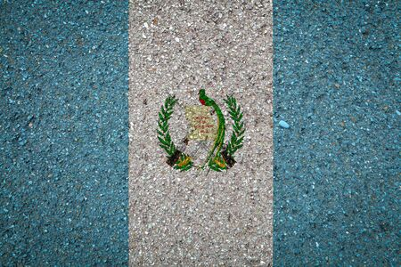 National flag of Guatemala on a stone background.The concept of national pride and symbol of the country.