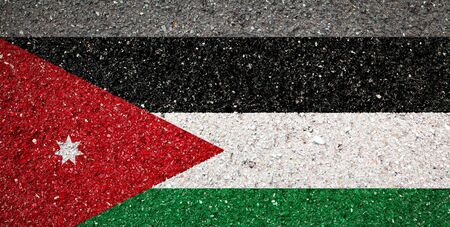 National flag of Jordan on a stone background.The concept of national pride and symbol of the country. 版權商用圖片