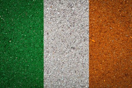 National flag of Ireland on a stone background.The concept of national pride and symbol of the country.