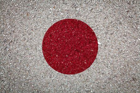 National flag of Japan on a stone background.The concept of national pride and symbol of the country.