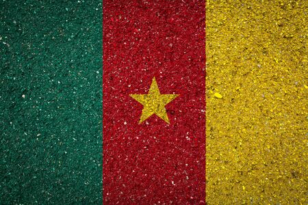 National flag of Cameroon on a stone background.The concept of national pride and symbol of the country.