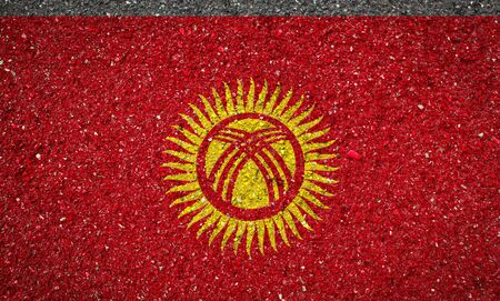 National flag of Kyrgyzstan on a stone background.The concept of national pride and symbol of the country.