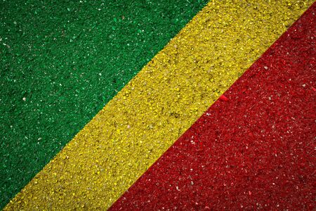 National flag of Republic of Congo on a stone background.The concept of national pride and symbol of the country.