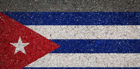 National flag of Cuba on a stone background.The concept of national pride and symbol of the country. 版權商用圖片