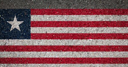 National flag of Liberia on a stone background.The concept of national pride and symbol of the country. 版權商用圖片