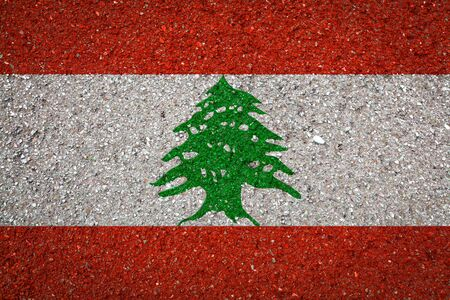 National flag of Lebanon on a stone background.The concept of national pride and symbol of the country. 版權商用圖片
