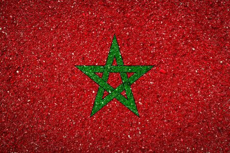 National flag of Morocco on a stone background.The concept of national pride and symbol of the country. 版權商用圖片
