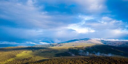Autumn Landscape Mountain Altai Chemalsky district: high mountains, forest , covered with clouds.  Panorama of mountains. 版權商用圖片
