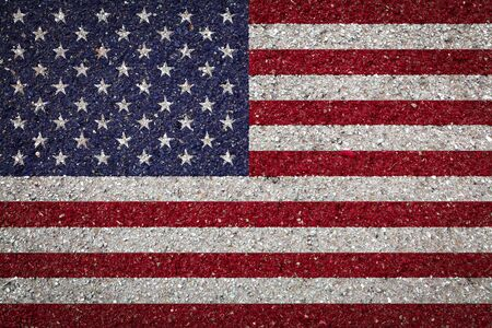National flag of USA on a stone background.The concept of national pride and symbol of the country.