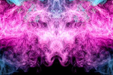 Cloud of blue and pink smoke  in the form of a skull, monster, dragon  on a black isolated background. Background from the smoke of vape. Mocap for cool t-shirts 版權商用圖片