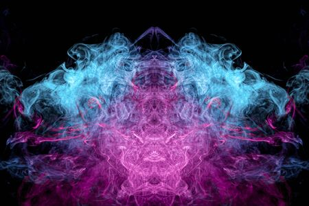 Dense multicolored smoke of   blue and purple colors in the form of a skull, monster, dragon on a black isolated background. Art of balance pattern black smoke on black background