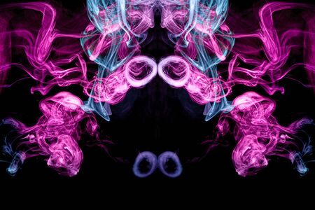Fantasy print for clothes: t-shirts, sweatshirts.  Colorful pink and blue smoke in the form of a skull, monster, dragon on a black isolated background. Background from the smoke of vape