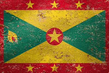 National flag of Grenada  on old peeling wall background.The concept of national pride and symbol of the country.