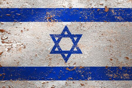 National flag of Israel on old peeling wall background.The concept of national pride and symbol of the country. Stock Photo