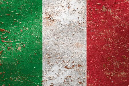 National flag of Italy on old peeling wall background.The concept of national pride and symbol of the country.