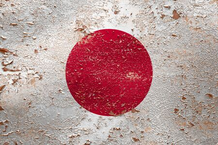 National flag of Japan  on old peeling wall background.The concept of national pride and symbol of the country. Zdjęcie Seryjne