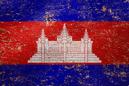National flag of Cambodia  on old peeling wall background.The concept of national pride and symbol of the country. Zdjęcie Seryjne